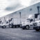 Delivering,Or,Supply,Concept,Image.,Trucks,Loading,At,Facility.